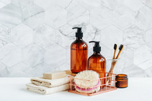 Toiletries Tube In A Bathroom Interior, Shower Gel, Shampoo And Bamboo Toothbrushes.