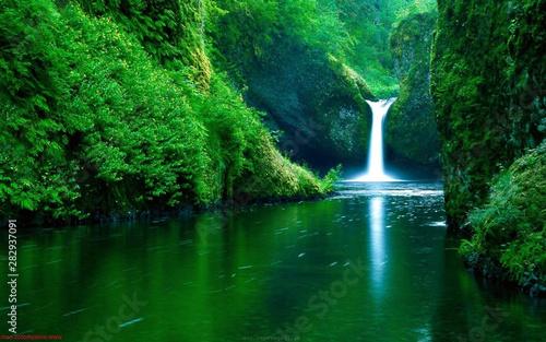 Waterfall flowing in a lake. Wallpaper Mural