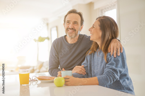 Obraz Beautiful romantic middle age couple having healthy breaskfast in the morning at home - fototapety do salonu