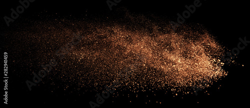 a shot from a firearm, an explosion of gunpowder on a black background, a bright flash with flying particles, abstract shape