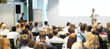 Leinwanddruck Bild Speaker Giving a Talk at Business Meeting. Audience in the conference hall. Business and Entrepreneurship. Panoramic composition suitable for banners.