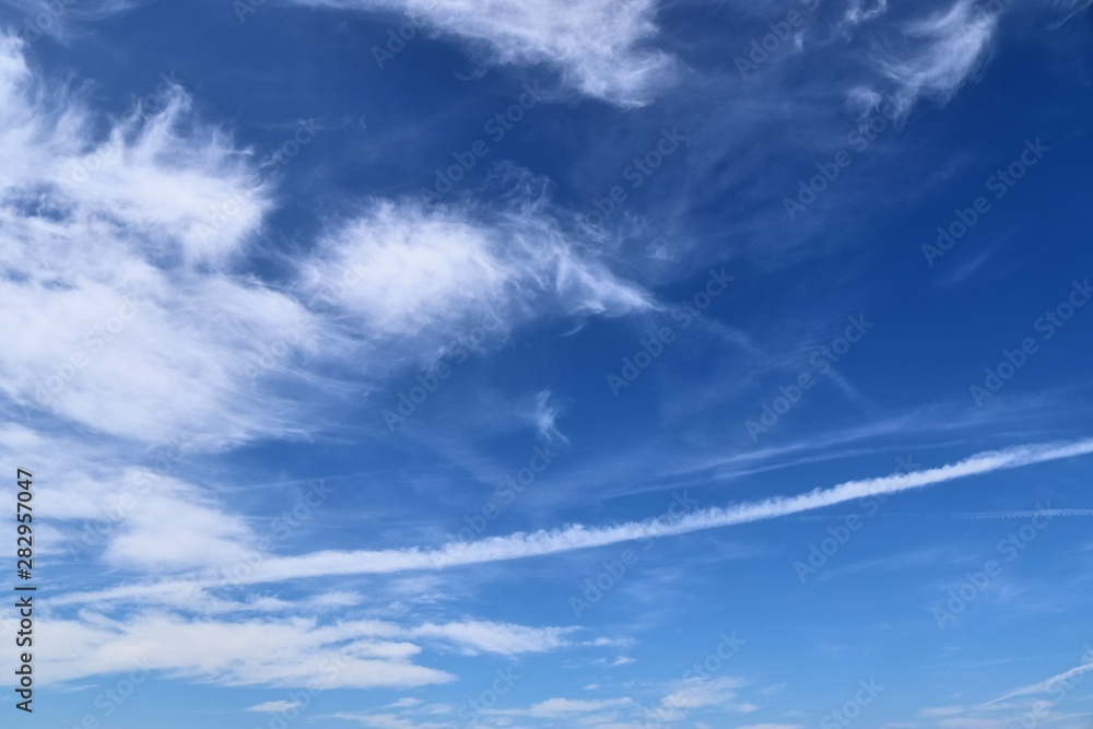 Fototapeta Beautiful white cirrus cloud formations on a deep blue sky