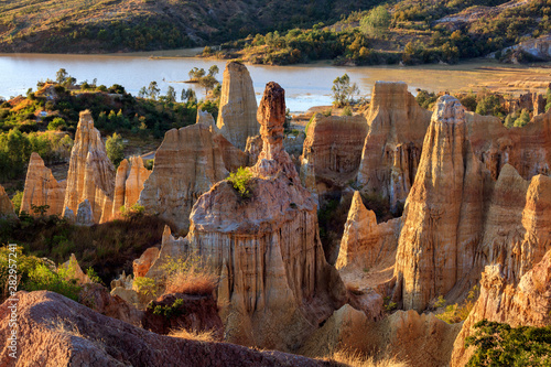 Papiers peints Marron chocolat Earth Forest of Yuanmou in Yunnan Province, China - Exotic earth and sandstone formations glowing in the sunlight. Naturally formed pillars of rock and clay with unique erosion patterns. China Travel