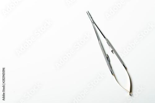 Photo  Curved needle holder for suture thread