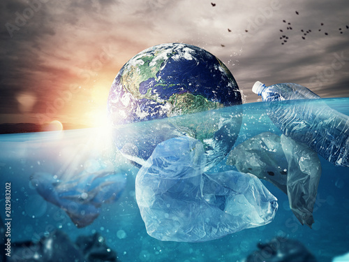 Fotomural  The Earth floats in the sea full of plastic