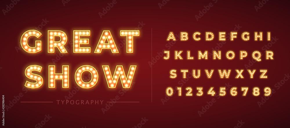 Fototapeta 3d light bulb alphabet with gold frame isolated on dark red background.