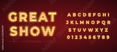 3d light bulb alphabet with gold frame isolated on dark red background Wallpaper Mural