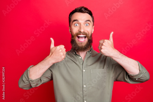 Obraz na plátně  Photo of excited friendly overjoyed man being glad to have bought something whil