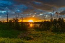 Sunset After Tornado At River