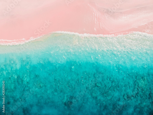 Deurstickers Lichtroze Tropical pink beach with blue ocean. Komodo islands
