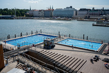 Helsinki, Finland 27.7.2019 Allas Sea Pool, Market Square, Presidental Palace And Behind Helsinki Lutherdal Catetral . Suomenlinna Ferry Has Just Arrived At The Beach. Sunny Summer Day In The Capital