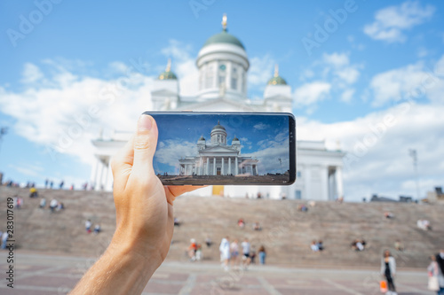 Stickers pour portes Taupe HELSINKI, FINLAND - JULY 27, 2019: Smartphone photo of touristic view of Helsinki Cathedral and Statue Of Emperor Alexander II Of Russia on the Senate Square, Helsinki, Finland