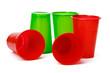 Leinwandbild Motiv Colored disposable cups for drinks isolated on white