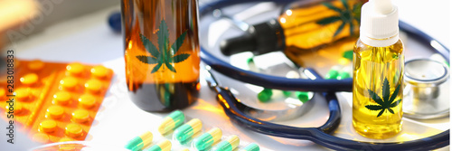 Photo  Marijuana oil medicinal pills with stethoscope