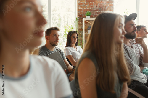 Photo  Group of students listen to presentation at university workshop
