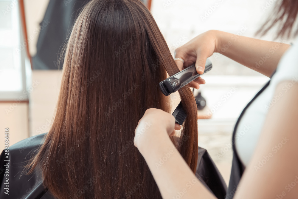 Fototapety, obrazy: Female hairdresser working with client in salon, closeup