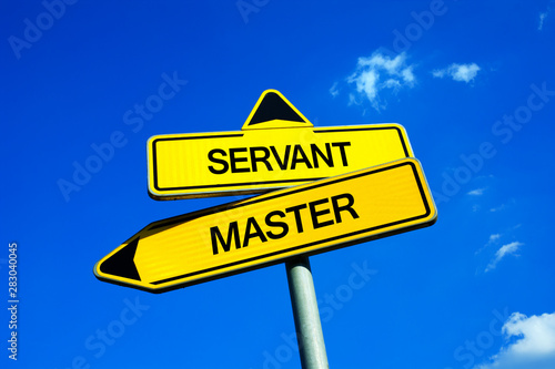 Photo  Master vs servant - Traffic sign with two options - being directing leader, employer and authority or being inferior worker and slave