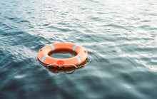 Life Buoy Floating On The Wate...