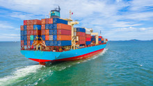 Container Cargo Ship Leaving The Industrial Port, Import And Export Business Commercial Trade Global Logistic And Transportation Of International By Container Cargo Ship In The Open Sea.