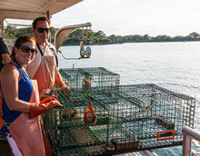 Two Tourists Working On Lobster Boat In Portand Maine