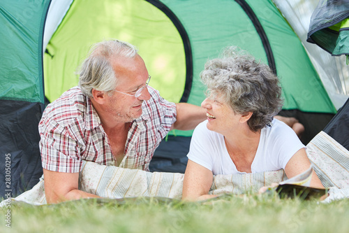 Happy couple seniors camping