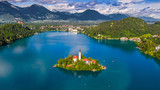 Bled, Slovenia - Aerial panoramic skyline view of Lake Bled (Blejsko Jezero) with the Pilgrimage Church of the Assumption of Maria, Julian Alps and Bled Castle at background on a sunny summer day