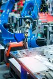 Fototapeta Kawa jest smaczna - Welding robot in the process