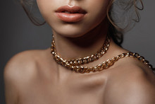Lips And Neck Of A Woman Close-up, Large Gold Chain Decoration On The Neck
