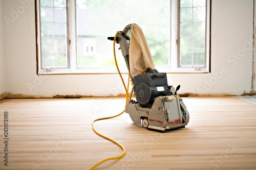 Obraz Sanding hardwood floor with the grinding machine only tool - fototapety do salonu