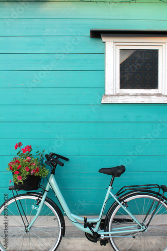 Recess Fitting Bicycle bicycle in front of a aquamarine wooden wall