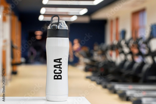 Plastic bottle or cup with Branched-chain amino acid drink close up Canvas Print
