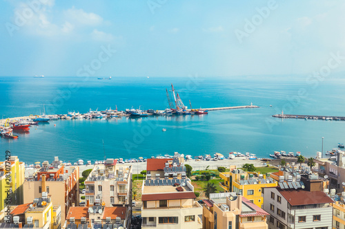 Fototapety, obrazy: Industrial port or harbor with container or cargo ships and cranes in iskenderun seaport at Hatay city of Turkey. Transportation and logistic at Mediterranean sea.