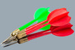 Red and green darts on a mirror background. Hit the target