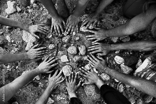 Women's gathering hands all coming together in a circle in nature Fototapet