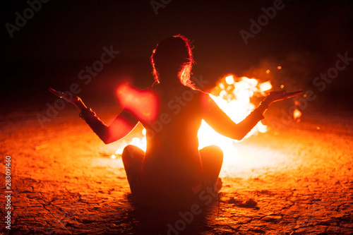 Fotografie, Tablou Woman Meditating With A Fire