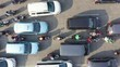JAKARTA, Indonesia - August 07, 2019: Top down view of vehicle moving slowly during rush hour on the street at the morning. Shot in 4k resolution from a drone flying upwards