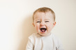 Leinwanddruck Bild - Baby with flu laughing