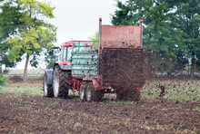Tractor Fertilizing Field With Dunk