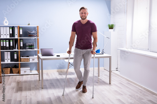 Tableau sur Toile Handicapped Man Walking With Crutches