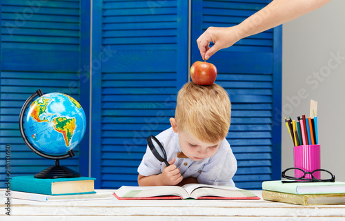 Clever and smart child, prodigy  A little boy is reading a
