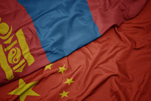 Waving Colorful Flag Of China And National Flag Of Mongolia.