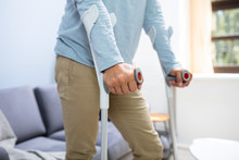 Disabled Man Using Crutches To...