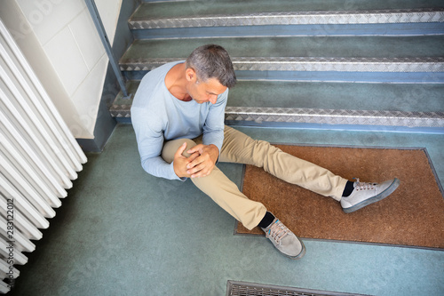 Mature Man Sitting On Staircase Fototapet