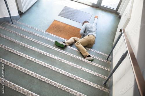 Fototapeta Unconscious Man Lying On Staircase obraz