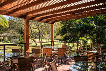 Wood Pergola And Tables In Garden Farm