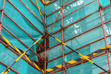 Corner Of Scaffolding And Protection Netting On An Unfinished Building