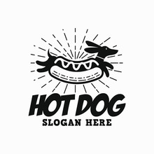 Hipster Hot Dog Logo. A Wiener In Bun With Sunburst