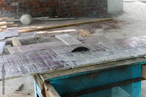 Obraz saw cutting wood inside an unfinish industrial loft - fototapety do salonu