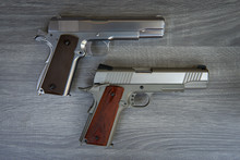 Two Stainless Hand Guns With B...