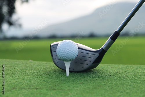 Deurstickers Golf Golf ball and golf club in beautiful golf course at sunset background. Golf ball on green in golf course at Thailand